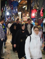Barefoot pilgrims on Via Dolorosa, in the Arab Market