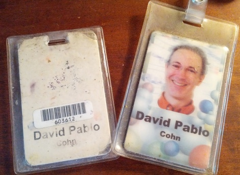 "original badge issued to me on Oct 24, 2002, next to the ""new improved"" security badge that we were given a few years ago"