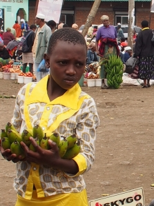 girl selling bananas