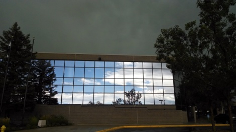 Blue skies in the reflection of the USAP building as the storm passes
